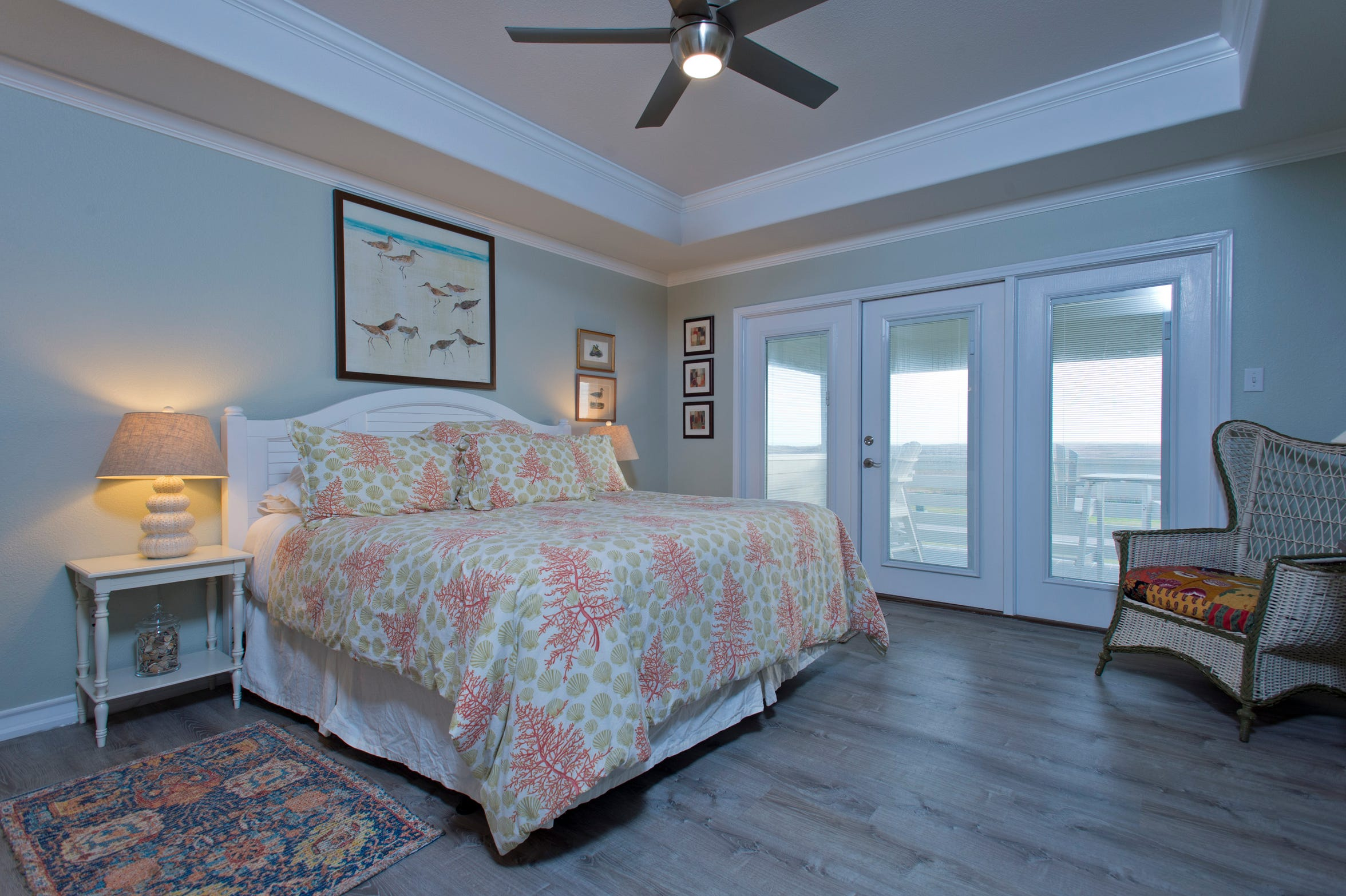 The top floor master bedroom overlooks the dunes and gulf from it's own private balcony patio