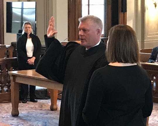 Mike Hess, of Circleville, is sworn in as judge for the Fourth District Court of Appeals Court in the Ross County Courthouse on Dec. 31, 2018. Hess was elected to fill the vacancy left by retiring Judge William Harsha.