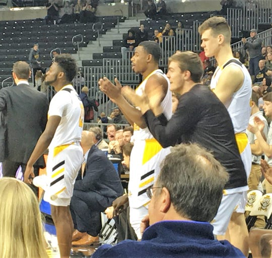 NKU players cheer late in the game.