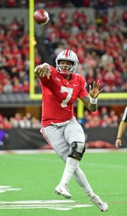 Ohio State Buckeyes quarterback Dwayne Haskins J.R. (7) drops back to pass in the second half against the Northwestern Wildcats in the Big Ten conference championship game at Lucas Oil Stadium.