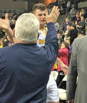 NKU senior Drew McDonald is congratulated by a fan as he walks off the floor following the Norse win over UIC.