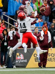 Virginia Tech Hokies wide receiver Eric Kumah (83) makes a touchdown catch under pressure from Cincinnati Bearcats cornerback Cameron Jefferies (14) in the first quarter of the Military Bowl at Navy–Marine Corps Memorial Stadium in Annapolis, Md., on Monday, Dec. 31, 2018. The game was tied at 14 after the first half.