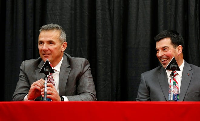Dec 4, 2018; Columbus, OH, USA; Ohio State Buckeyes head coach Urban Meyer (left) addresses members of the media to announce his intentions to step down from coaching after the Rose Bowl game.  Meyer is pictured with newly named head coach Ryan Day during the press conference at the Ohio State University Fawcett Center.