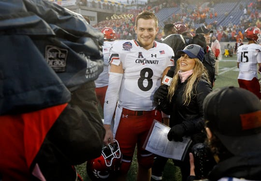 Cincinnati Bearcats quarterback Hayden Moore (8) smiles as he's interviewed by ESPN after the fourth quarter of the Military Bowl at Navy–Marine Corps Memorial Stadium in Annapolis, Md., on Monday, Dec. 31, 2018. The Bearcats took home the Military Bowl trophy and complete the team's third-ever 11-win season.