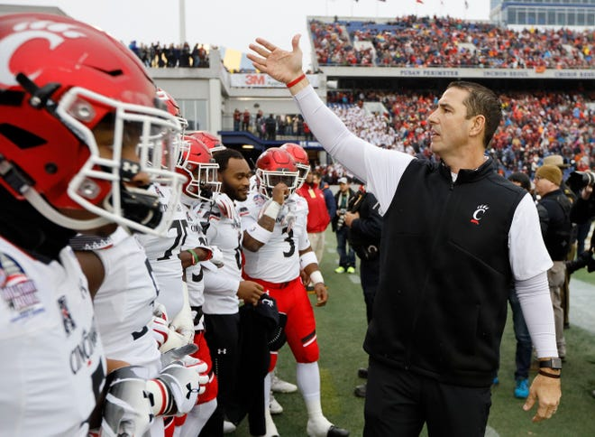 Cincinnati Bearcats head coach Luke Fickell readies his team to take the field in the first quarter of the Military Bowl at Navy–Marine Corps Memorial Stadium in Annapolis, Md., on Monday, Dec. 31, 2018. The game was tied at 14 after the first half.