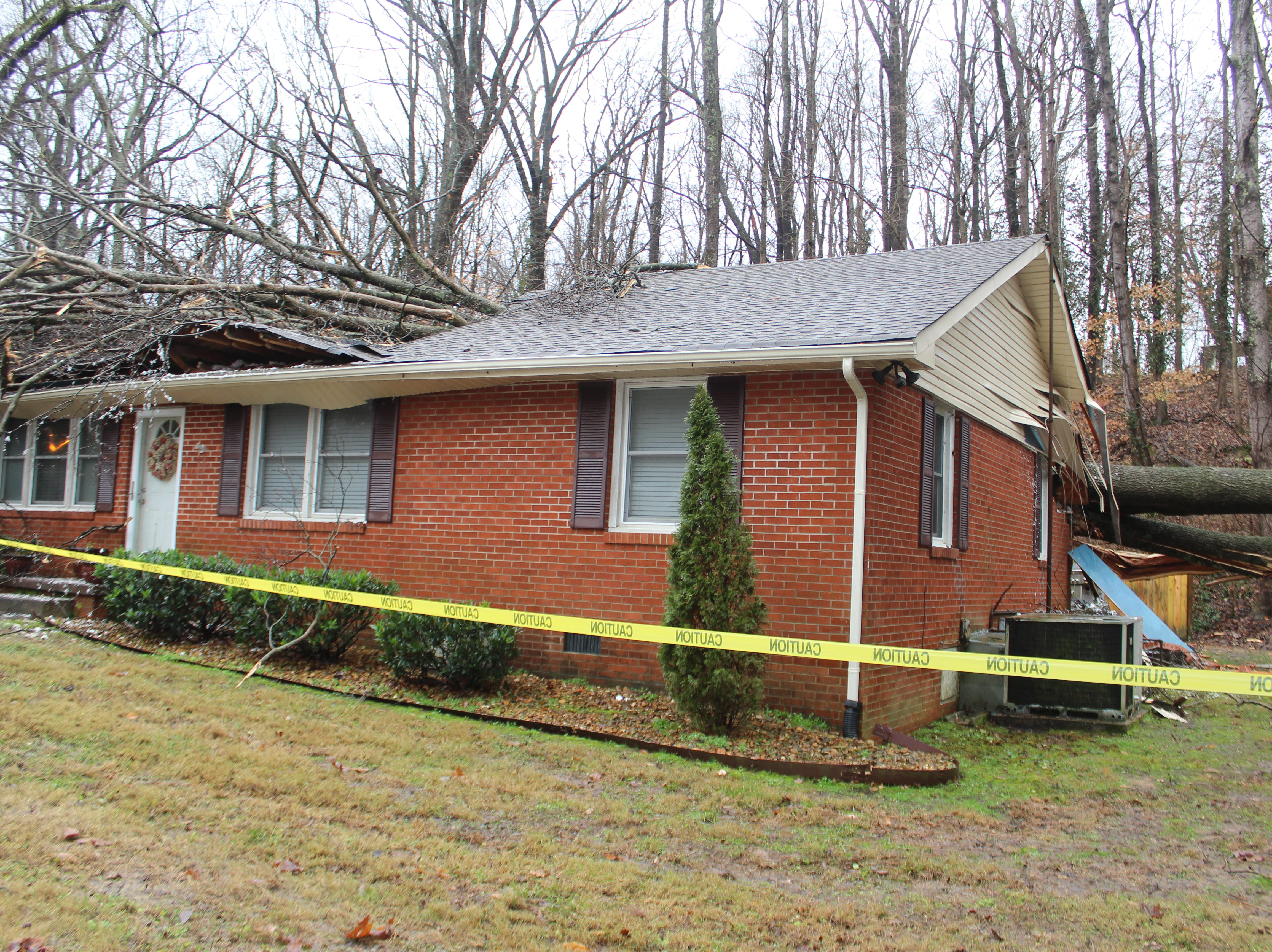 A tree smashed into this home on Hickory Grove Blvd. in Clarksville on Monday afternoon as strong storms swept through the area.