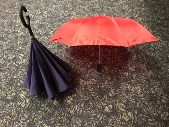 The inverted umbrella stands up and the rain caught inside falls out of the second fold, while a traditional umbrella gets your hands wet and takes up more room when you dry it out.