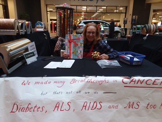 Volunteer Barbara Pollak, at Hadassah's Giftwrap booth in Brunswick Square Mall, where volunteers and customers helped raise thousands for Cancer and Medical Research.