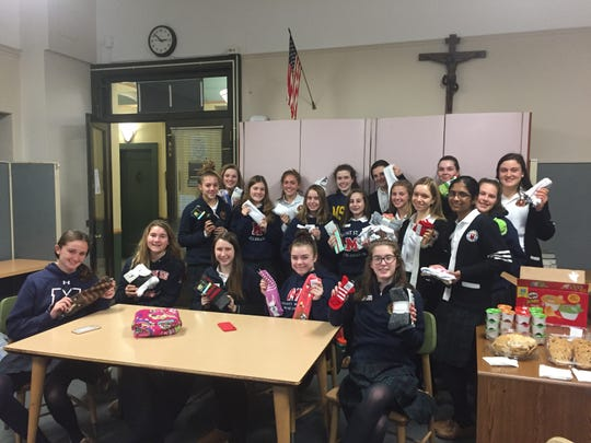 "More than 300 pairs of socks were collected during the Mount Saint Mary Academy HOPE Club's ""Sock It to Me"" drive which was held during November and December."