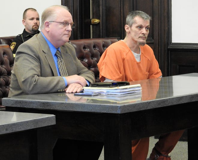 Attorney Jeffrey Mullen with client Murel D. Parks Jr., 46, of Coshocton. Parks was sentenced to an aggregate term in prison of four years for one count of failure to comply with the order or signal of a police officer and one count of trafficking in methamphetamine.