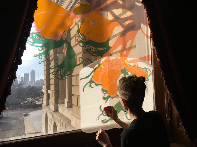 Lee Emma Running installed her colorful vinyl artwork on a window in the governor's office at the State Capitol on Dec. 19, 2018.