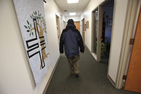 From 2012: Father Everett Hemann many walks to his office in the rectory next to St. Patrick's Catholic Church in Cedar Falls.