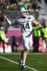 Michigan State quarterback Brian Lewerke looks to pass against Oregon during the first half of the Redbox Bowl on Monday, Dec. 31, 2018, in Santa Clara, Calif.
