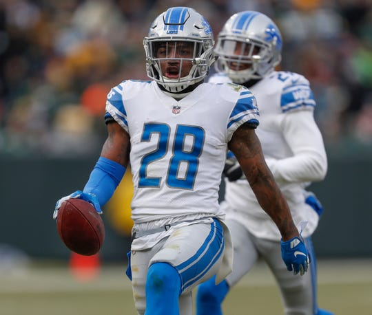 Detroit Lions' Quandre Diggs reacts after intercepting a pass during the second half against the Green Bay Packers, Sunday, Dec. 30, 2018, in Green Bay, Wis.