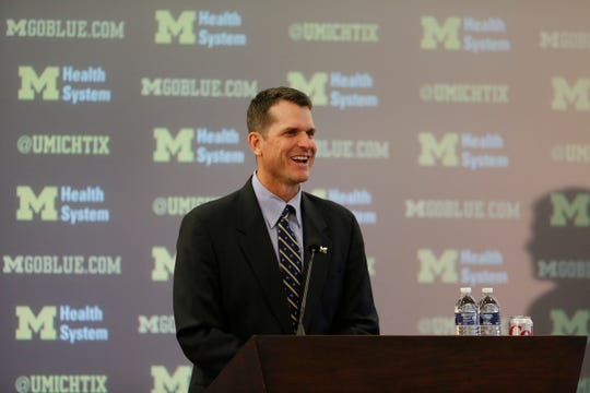 Jim Harbaugh answering questions as the new Michigan football coach in Ann Arbor on Dec. 30, 2014.