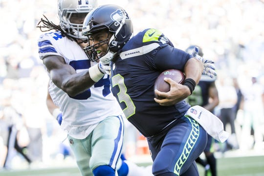Cowboys linebacker Jaylon Smith runs Seahawks quarterback Russell Wilson out of bounds Sept. 23, 2018 at CenturyLink Field in Seattle. Seattle won, 24-13.