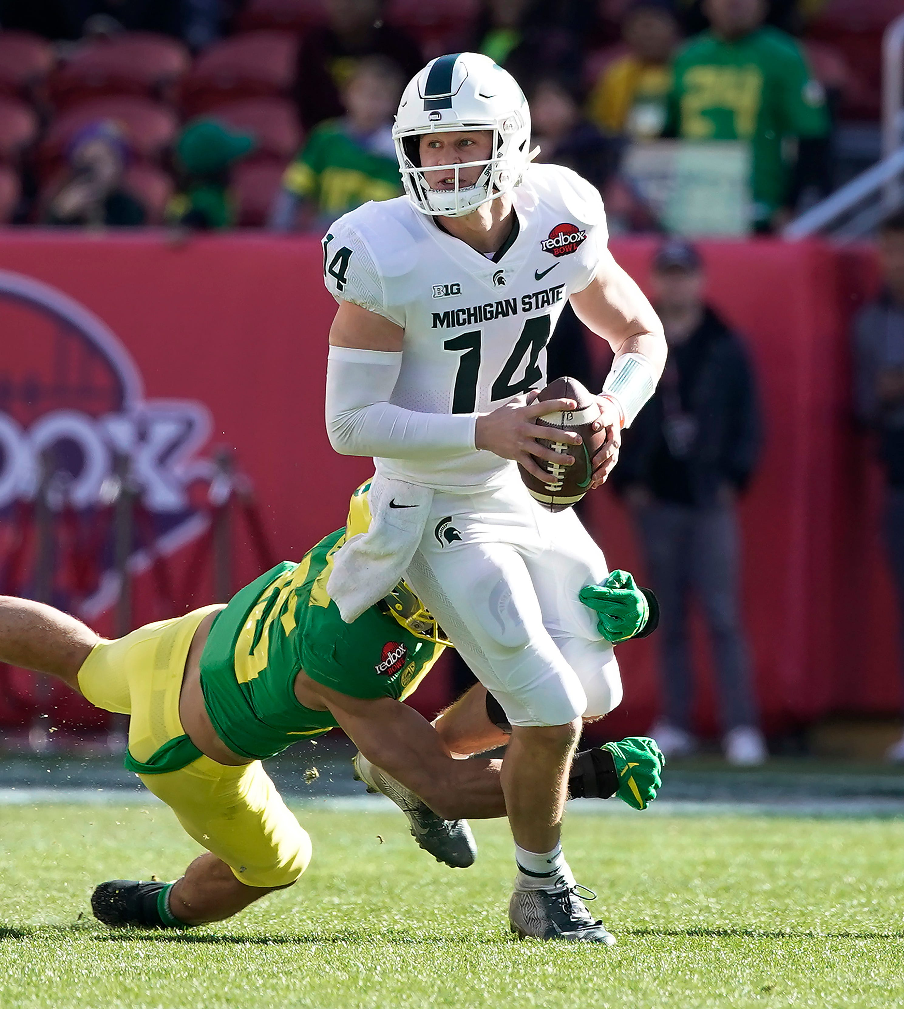 Michigan State quarterback Brian Lewerke is sacked by Oregon's Brady Breeze during the first half of the Redbox Bowl on Monday, Dec. 31, 2018, in Santa Clara, Calif.