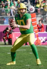 Oregon quarterback Justin Herbert looks to throw the football against Michigan State during the first quarter of the Redbox Bowl at Levi's Stadium on Monday, Dec. 31, 2018.