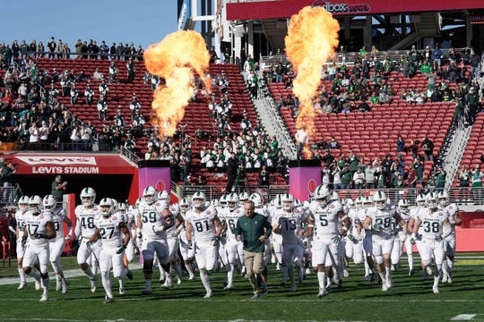 Michigan State coach Mark Dantonio runs onto the field with the team before the Redbox Bowl against Oregon at Levi's Stadium on Monday, Dec. 31, 2018.