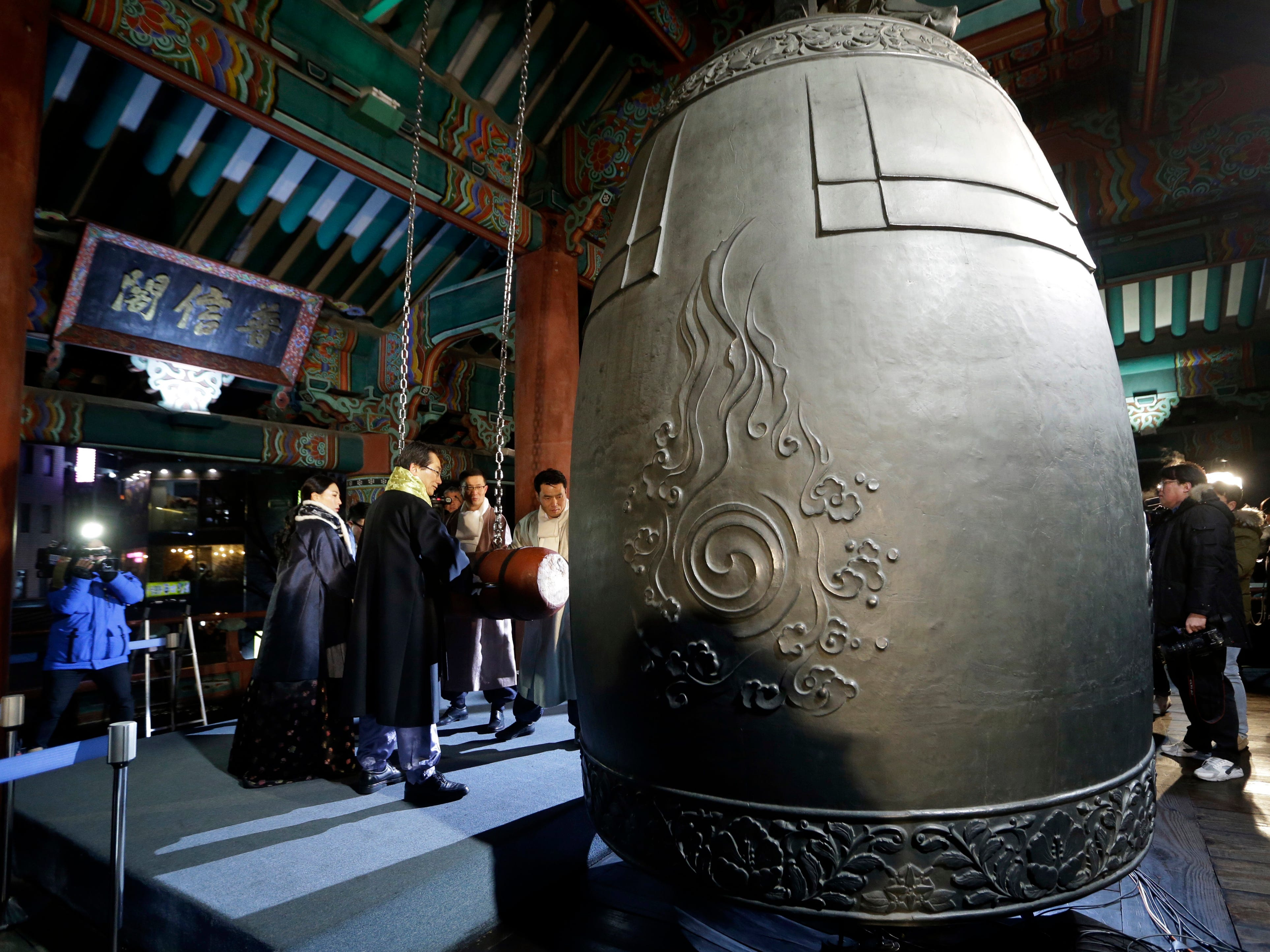 People strike a huge traditional bell during New Year's celebrations in Seoul, South Korea, on Jan. 1, 2019.