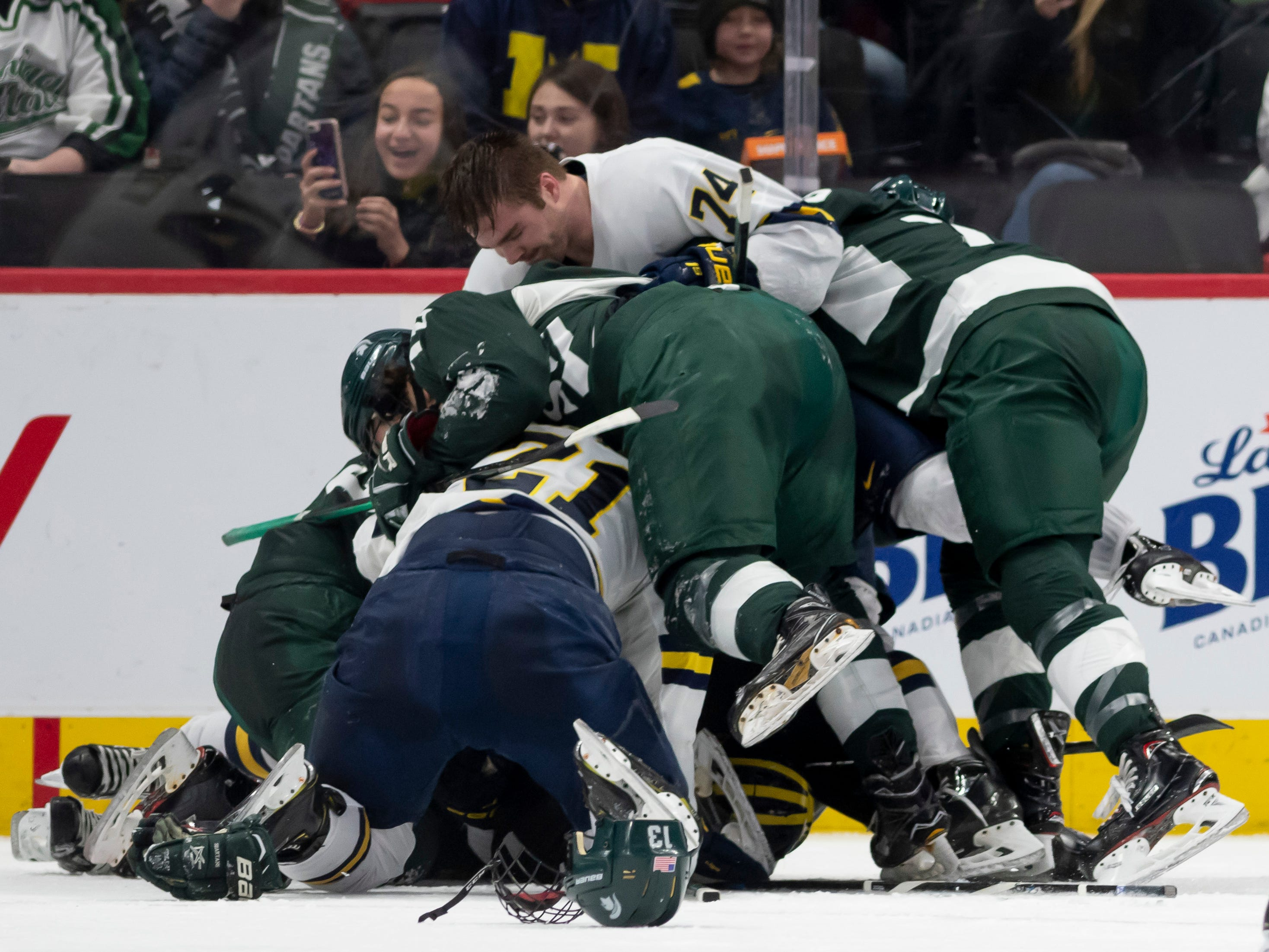 The two teams pile on top of each other during a fight in the first period.  Both teams were given multiple penalties.