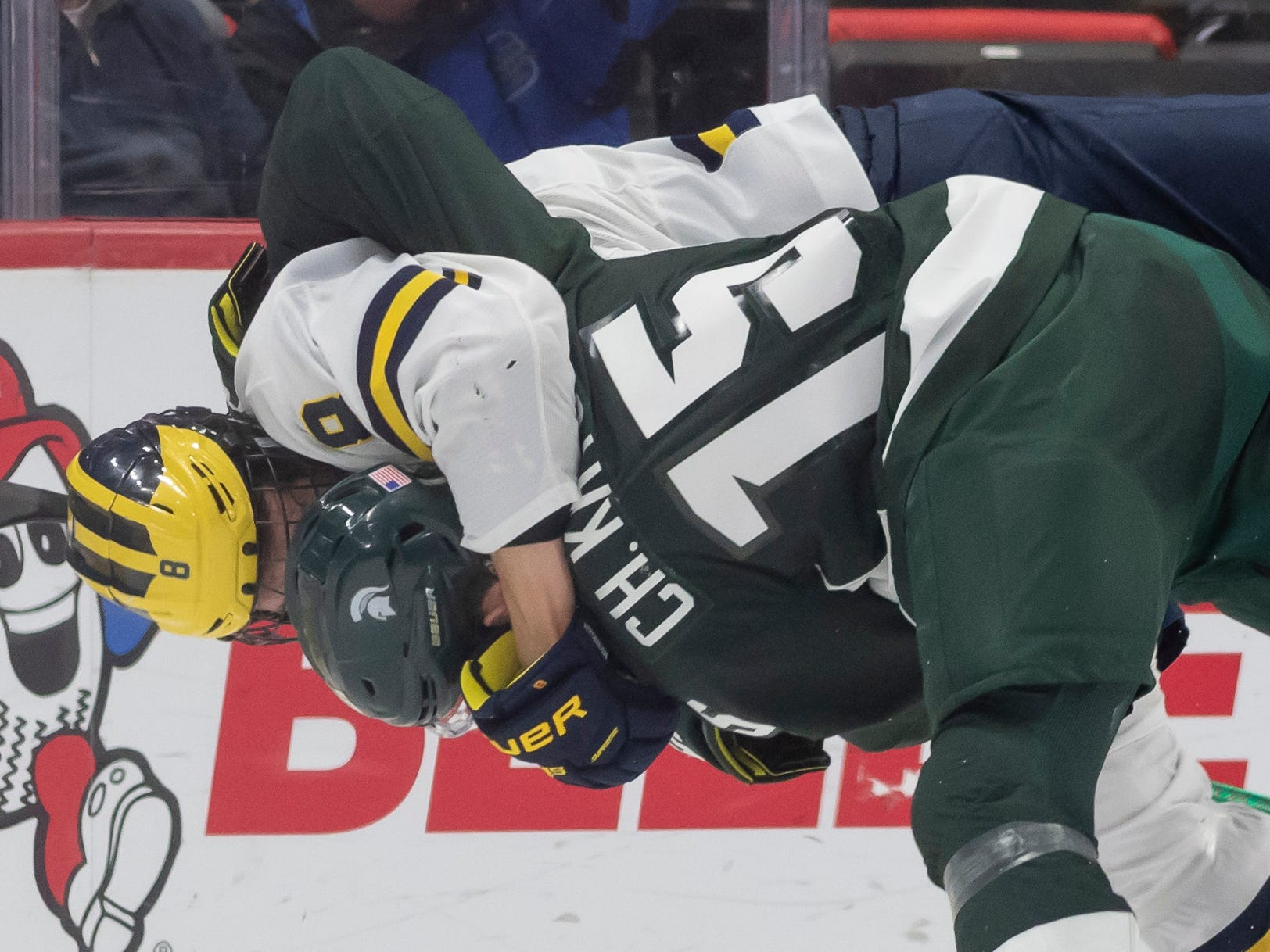 Michigan forward Jack Becker and Michigan State defenseman Christian Krygier duke it out during a fight in the first period.