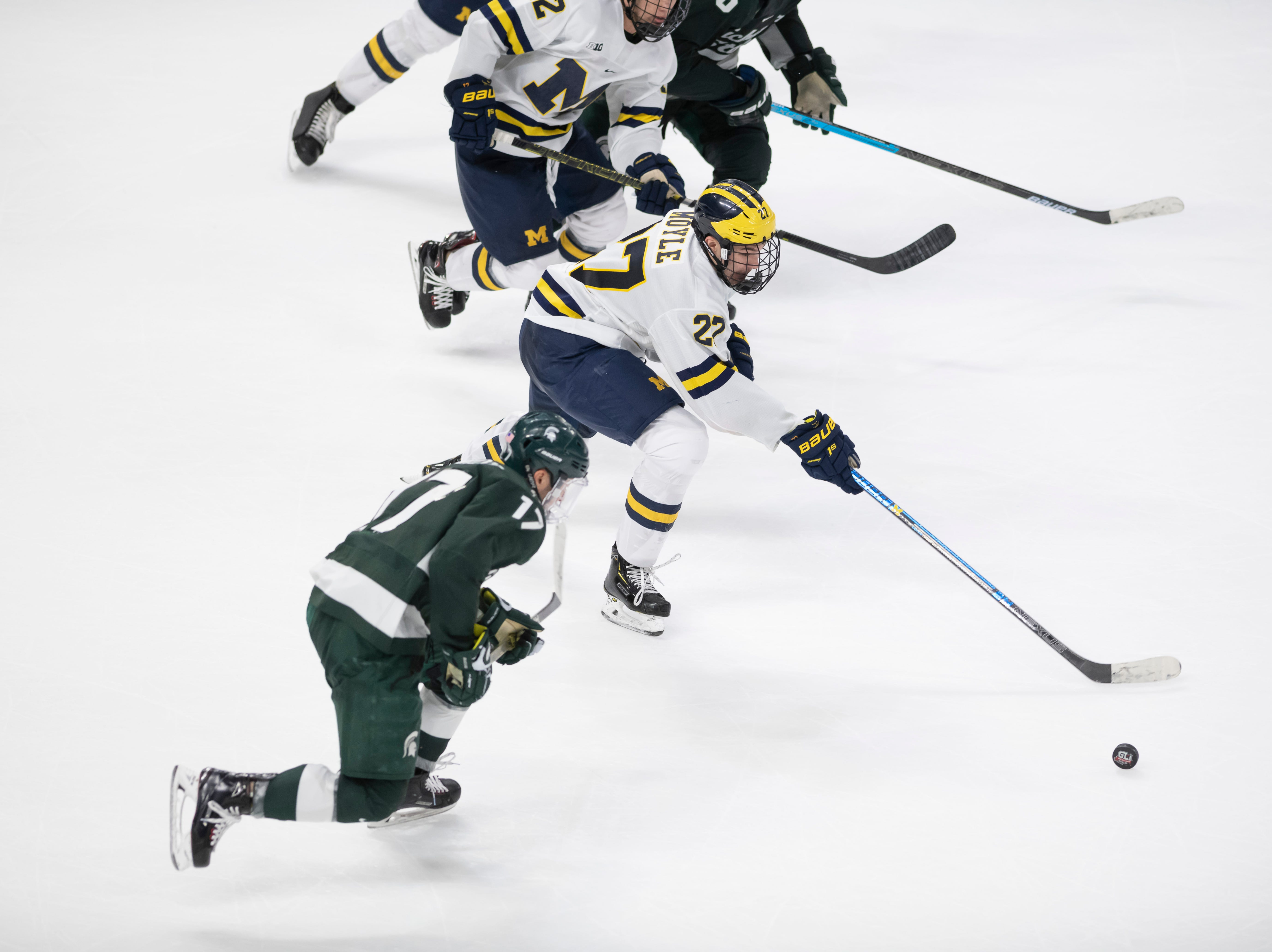 Michigan forward Nolan Moyle moves the puck up the ice in the overtime period.