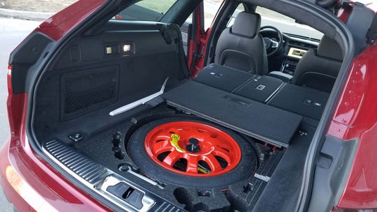 The Jaguar XF Sportbrake comes with loads of cargo room -and a spare tire for when a Detroit pothole eats a tire.