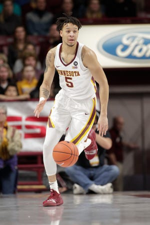 Minnesota guard Amir Coffey (5) plays against Mount St. Mary's.