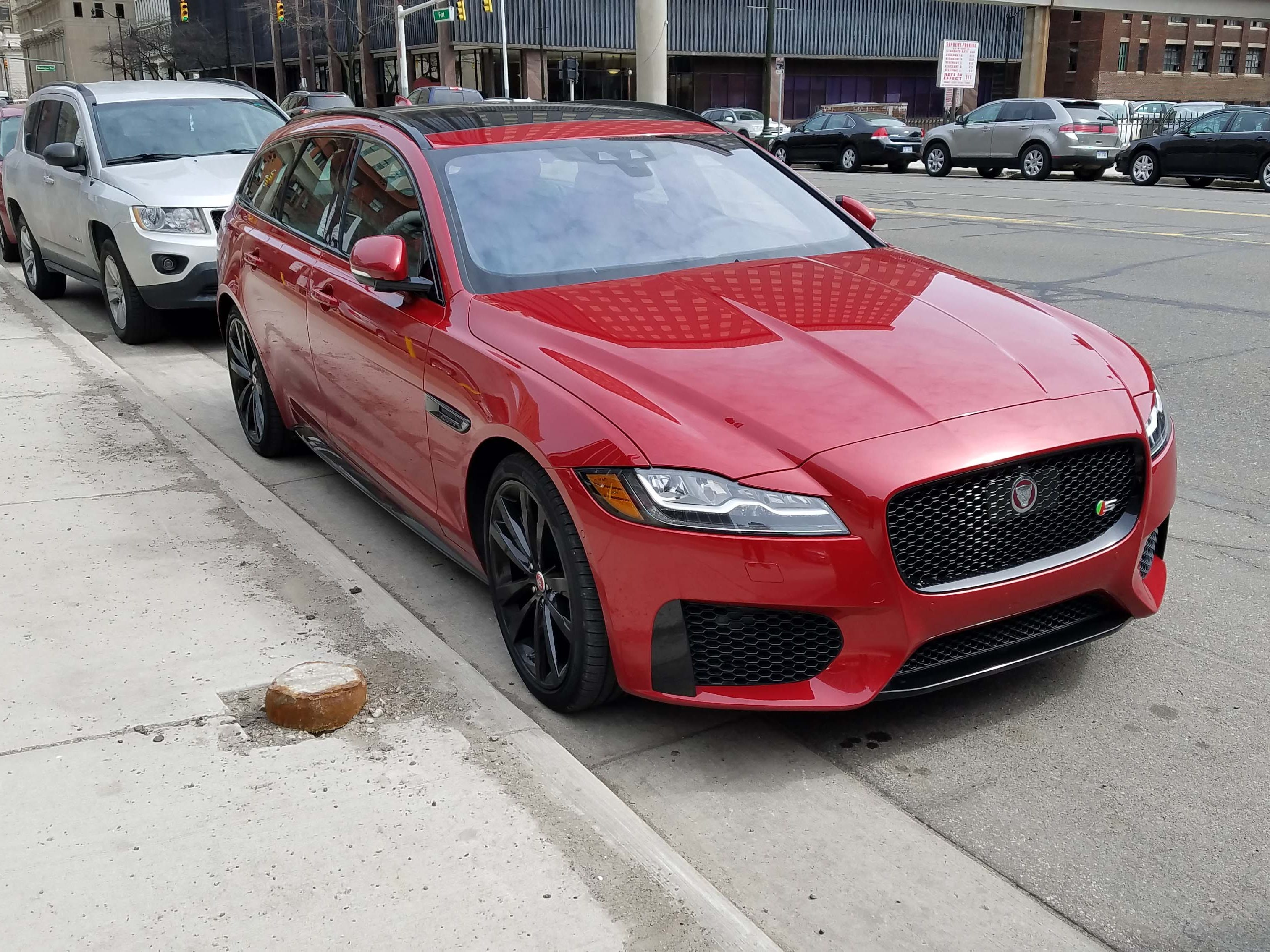 The Jaguar XF Sportbrake stands out on Detroit's downtown streets — and its self-assist feature can automatically pull into parallel parking spaces.