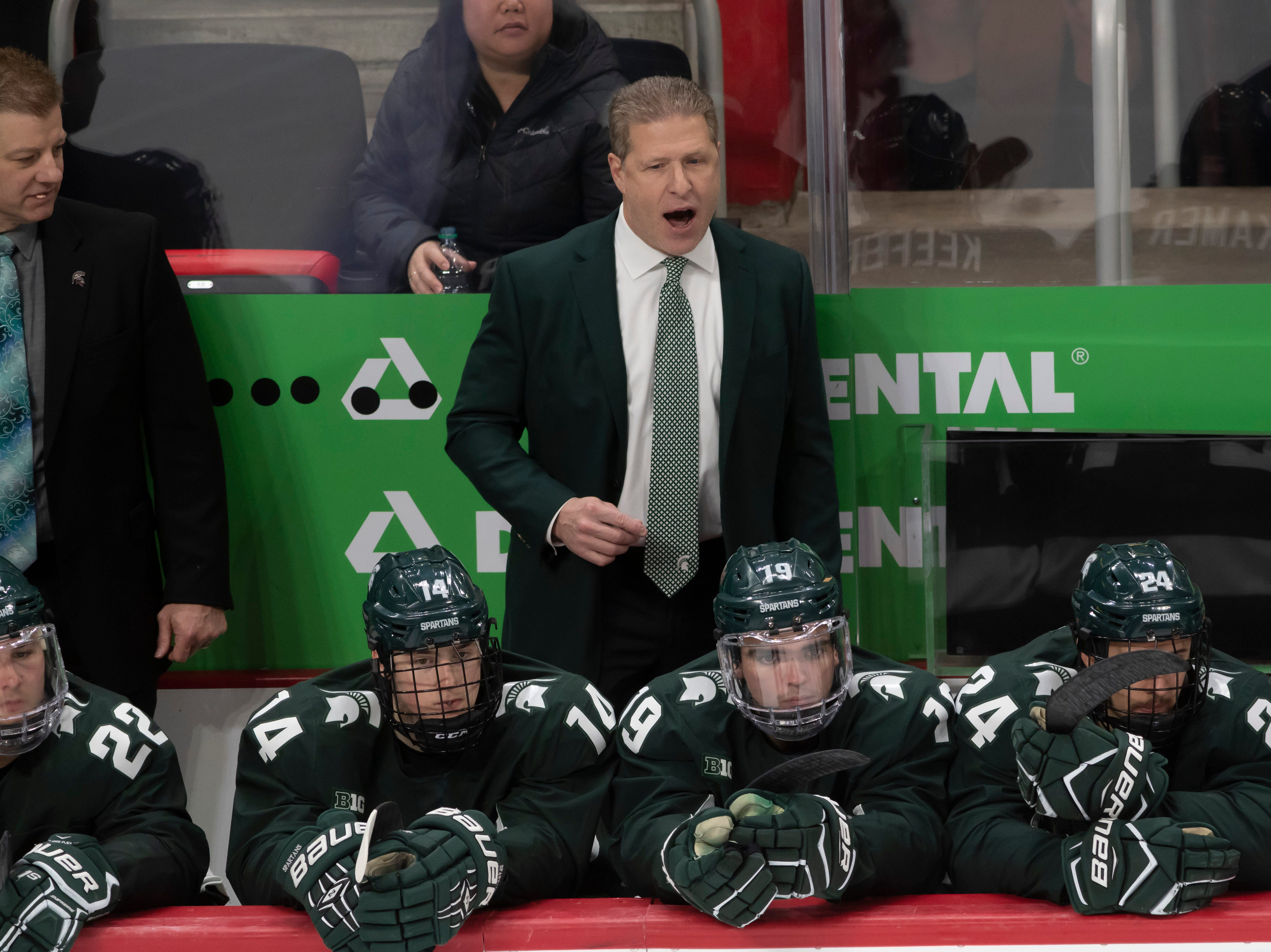Michigan State head coach Danton Cole talks to his players in the third period.