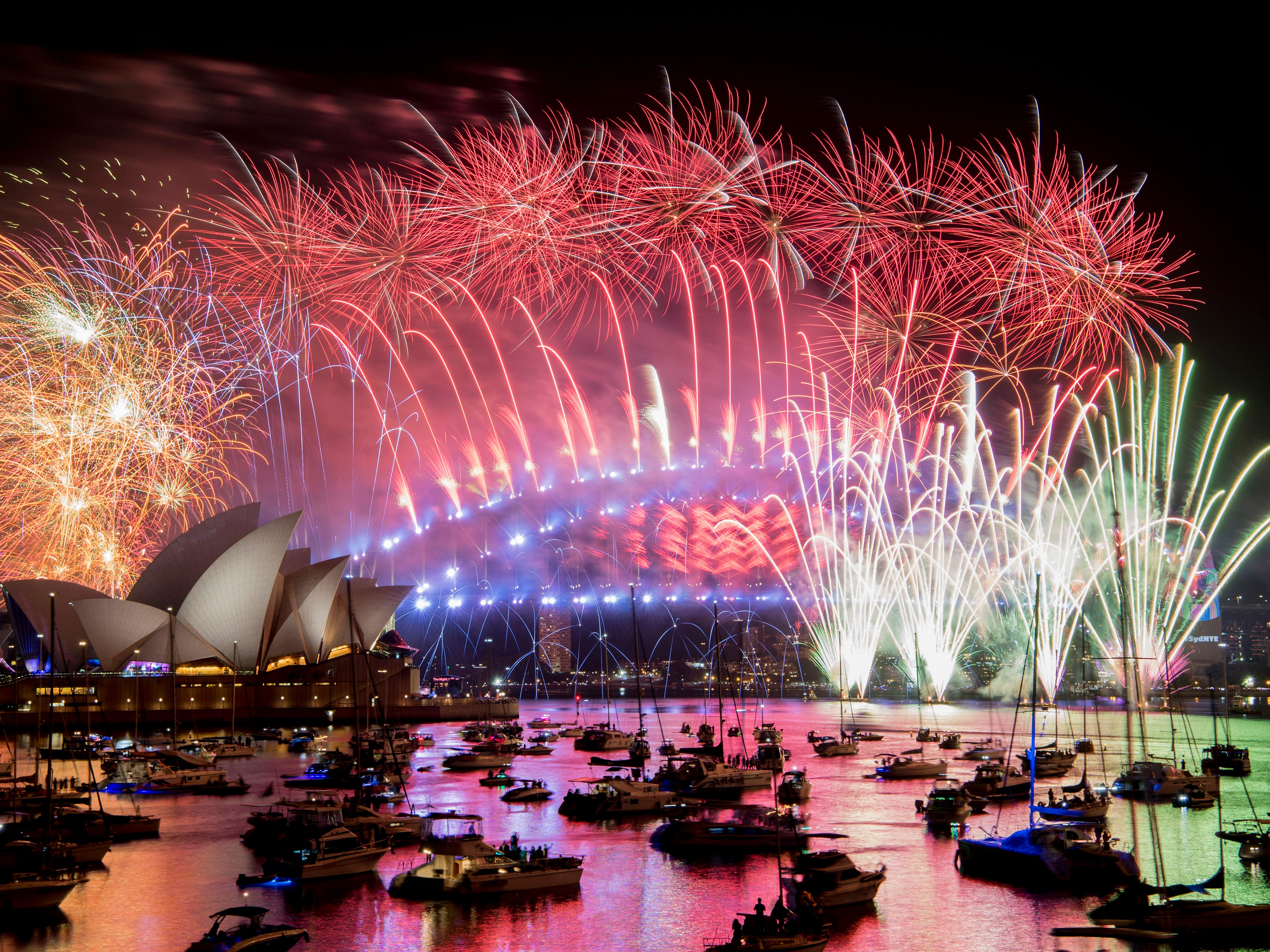 Fireworks explode over the Sydney Harbour during New Year's Eve celebrations in Sydney, on Jan. 1, 2019.