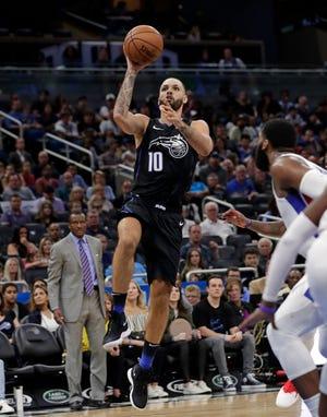 The Orlando Magic's Evan Fournier releases his winning shot against the Detroit Pistons.