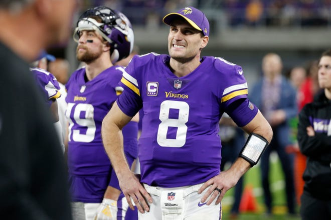 Minnesota Vikings quarterback Kirk Cousins watches from the bench during the second half.