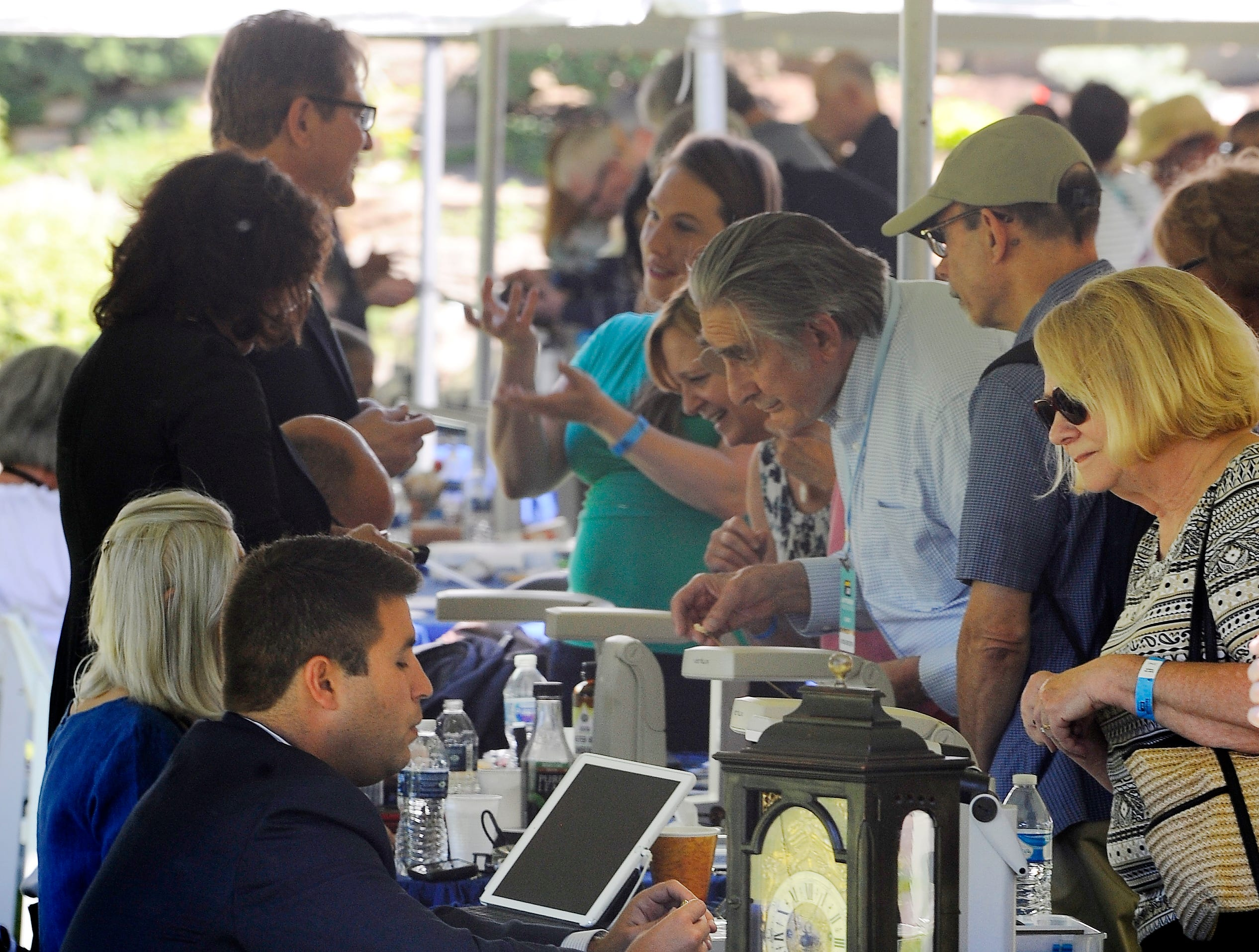 Dozens of appraisers were in place in tents on the grounds at Meadow Brook to determine the value of various vintage items.