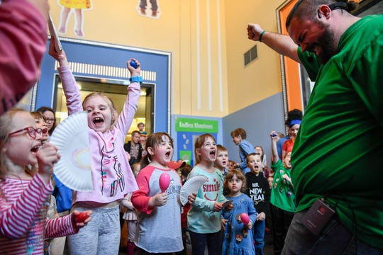 """The Koch Family Children's Museum of Evansville celebrated the New Year with their annual noon """"Ball Drop"""" into a sea of cheering children and parents gathered in the entrance of the museum in downtown Evansville, December 31, 2018."""