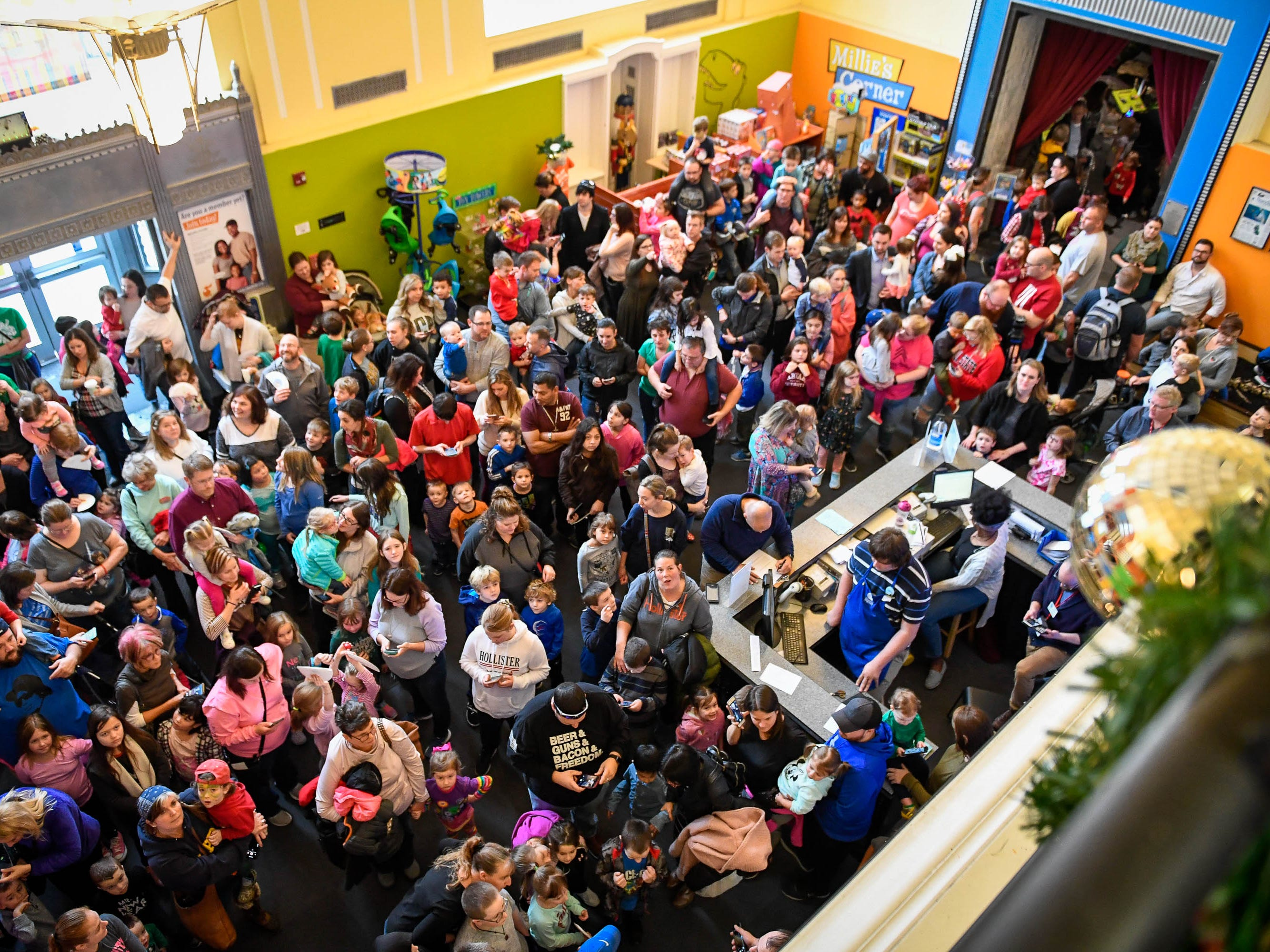 "A packed house awaits the annual noon ""Ball Drop"" celebrating the New Year at the Koch Family Children's Museum of Evansville Monday, December 31, 2018."