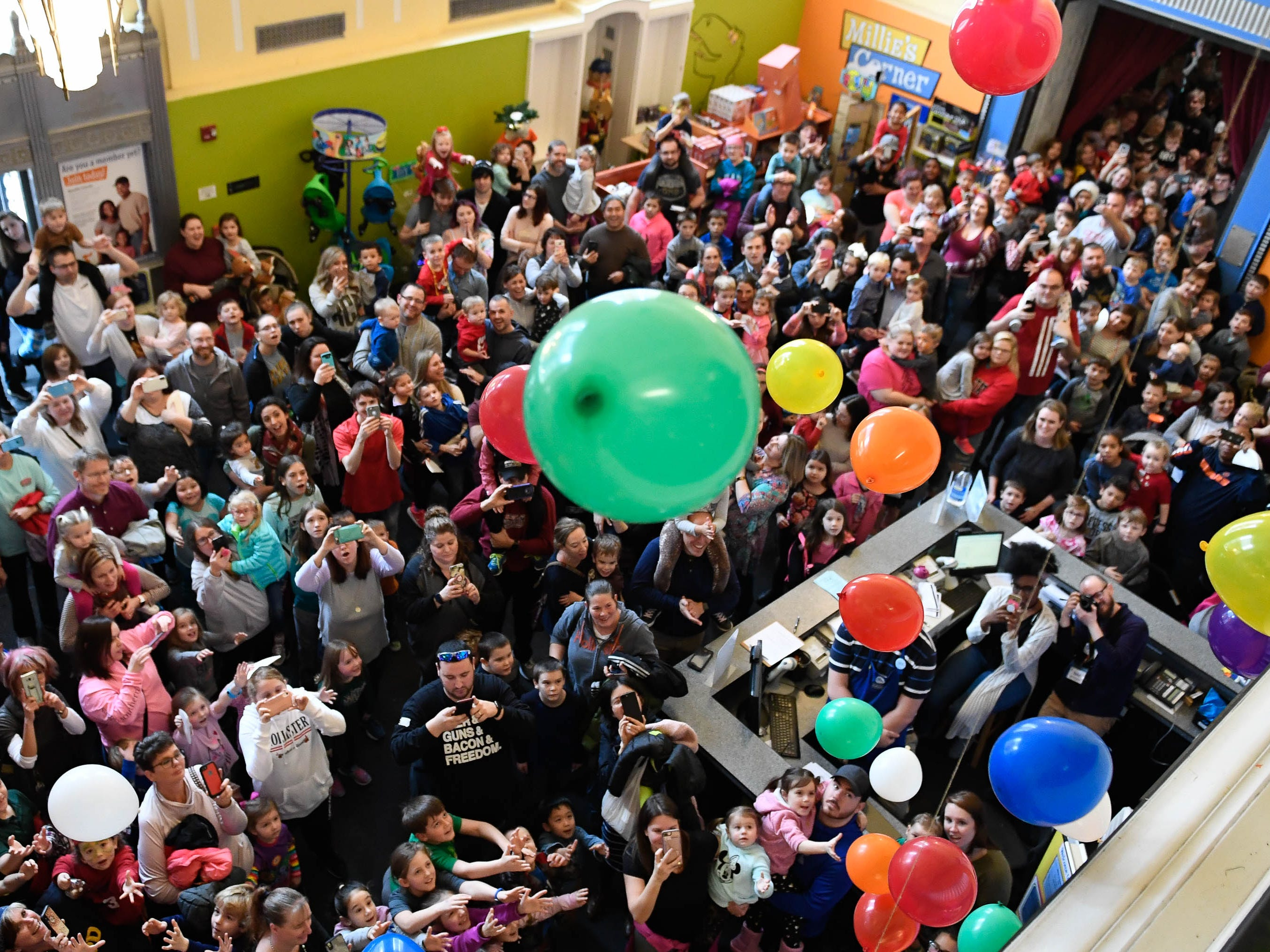 "The Koch Family Children's Museum of Evansville celebrated the New Year with their annual noon ""Ball Drop"" into a sea of cheering children and parents gathered in the entrance of the museum in downtown Evansville, December 31, 2018."