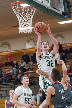 Wood Memorial's Paxon Bartley (32) takes a shot during the Wood Memorial vs North Posey game of the 2018 Toyota Classic Friday, Dec. 21, 2018.