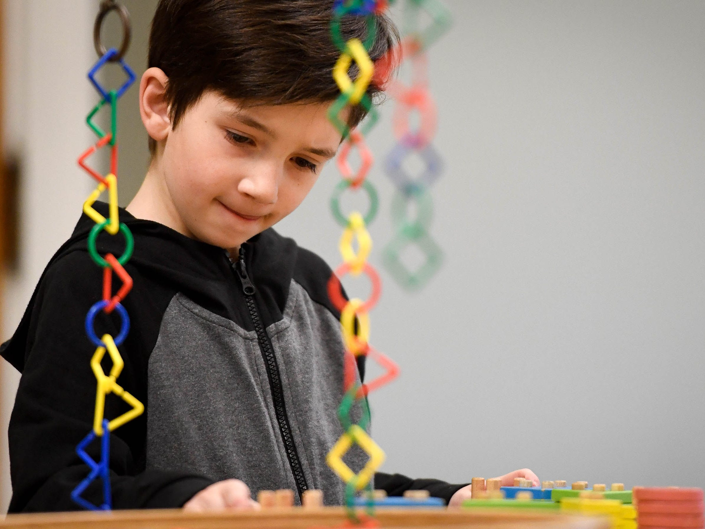 "Harrison Boyd, eight years-old, concentrates on a building project while visiting the Koch Family Children's Museum of Evansville for their annual noon ""Ball Drop"" celebrating the New Year Monday, December 31, 2018."