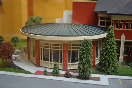 The large picture windows and outdoor tables are included in the Main Station Café section of the model.