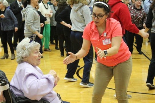 Julie Shaull, right, dances with Marilyn Bagley as the clock struck noon Monday. Seniors like Bagley were celebrating early at the annual Noon Year's Eve at the Sandusky County YMCA.