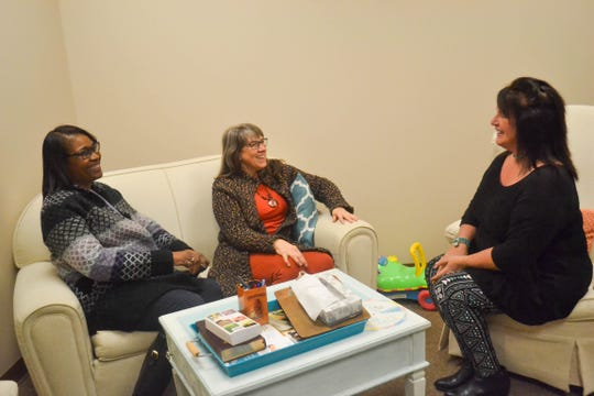 Staff from Heartbeat of Ottawa County sit in the client services counseling room. From left are Yvette Rash, client services; Executive Director Kim Perkins, and Marketing Specialist Sandy Hymore.