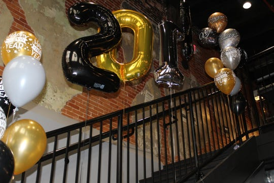 Decorations celebrating the arrival of 2019 were already up Monday afternoon at The Garrison. The restaurant was one of several downtown Fremont businesses planning to celebrate New Year's Eve Monday night.