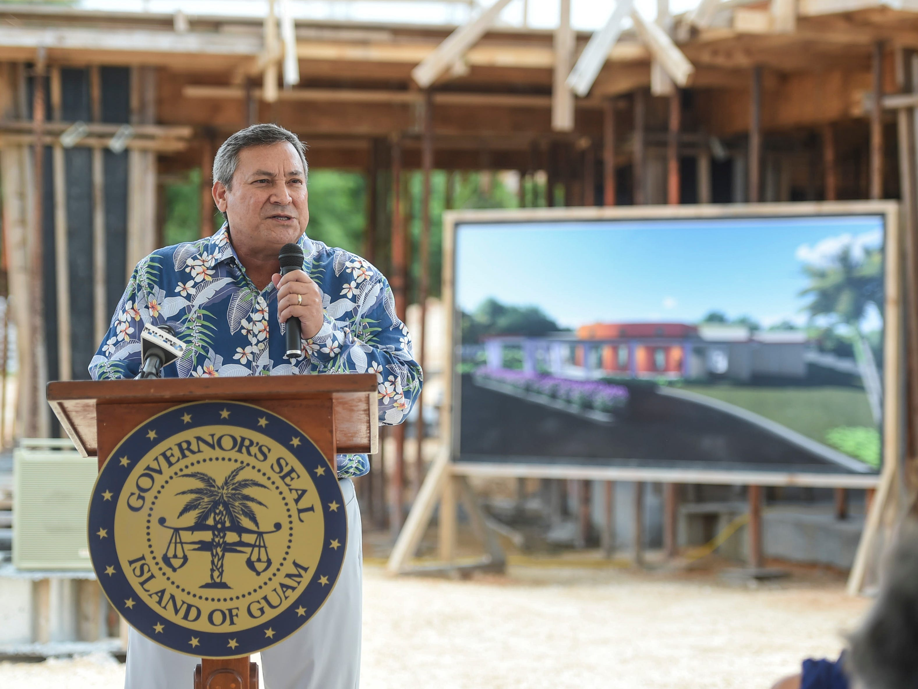 Gov. Eddie Baza Calvo speaks on the services and accomplishments of Sister Mary Brigid Perez during a ceremony recognizing the redesignation of the former Rigålu House to I Guma Mina'åse' Sister Mary Brigid Perez, R.S.M. in Barrigada on Dec. 31, 2018.