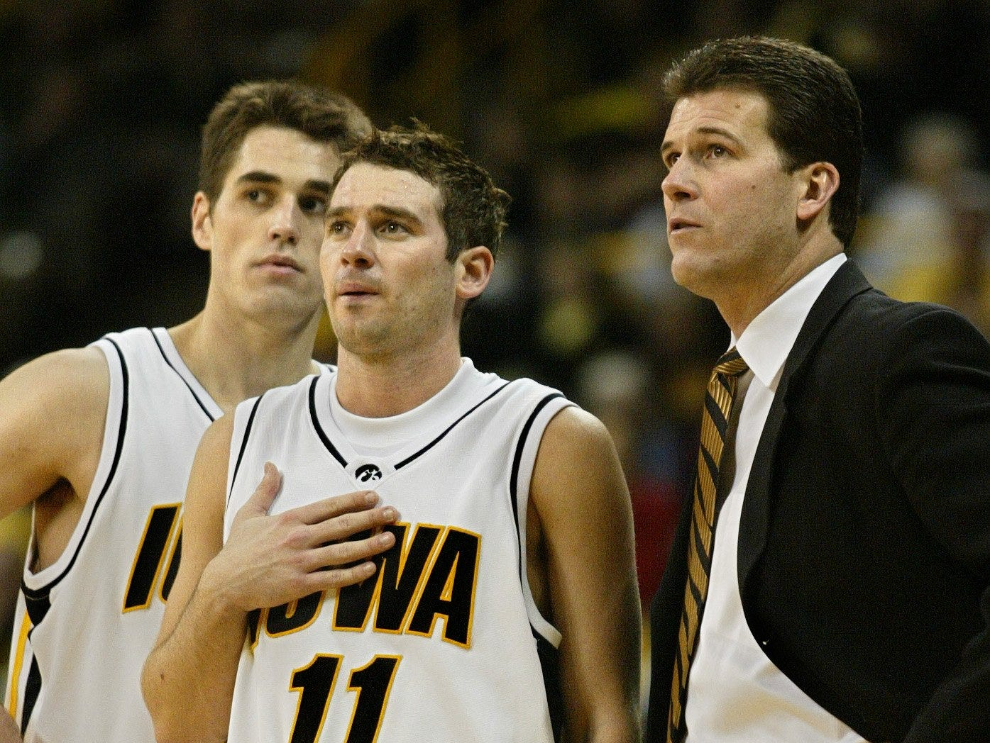 From 2003: Iowa's Brody Boyd (11) stands with Jeff Horner and coach Steve Alford during game against Purdue.