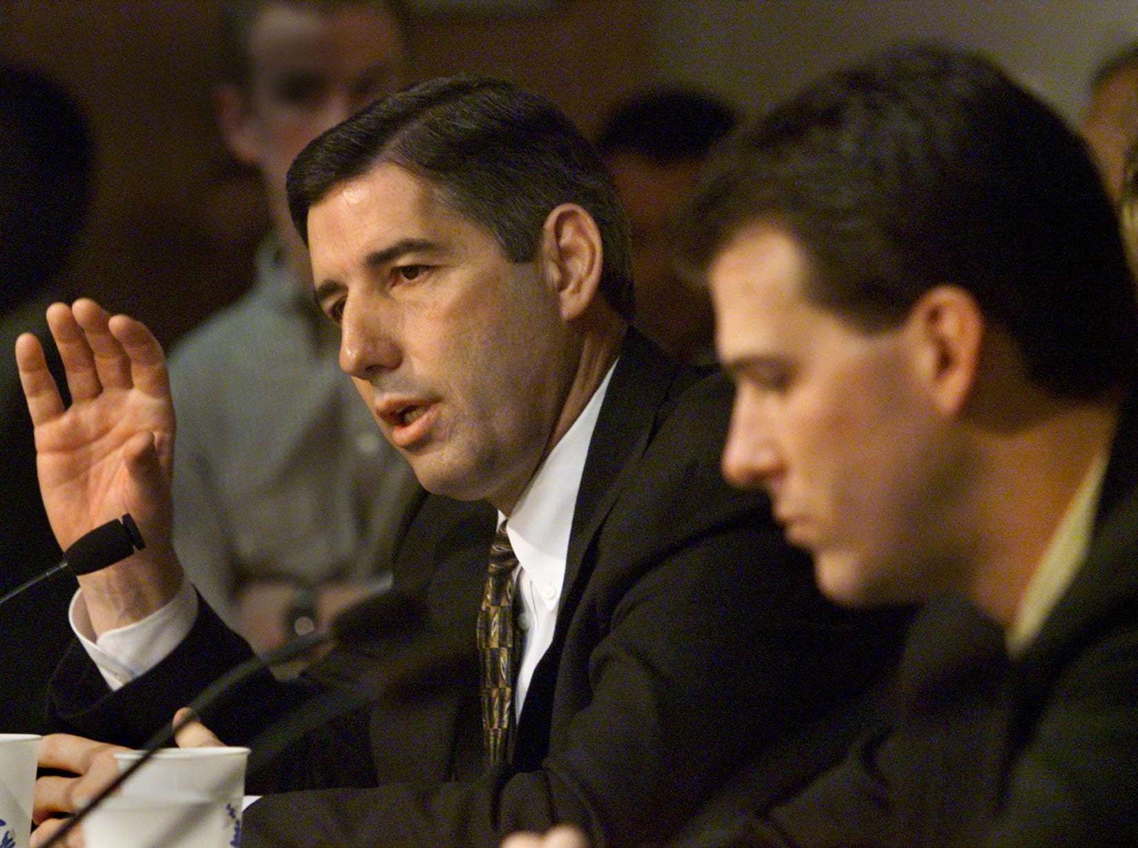 From 1999: Iowa Athletic Director Bob Bowlsby, left, answers questions March 22, 1999, about the hiring of basketball coach Steve Alford, right.