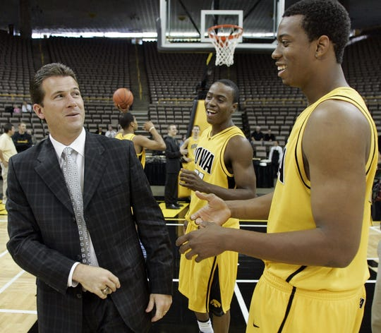 From 2006: Iowa coach Steve Alford jokes with Justin Johnson, center and David Palmer at media day on prior to the 2006-07 basketball season.