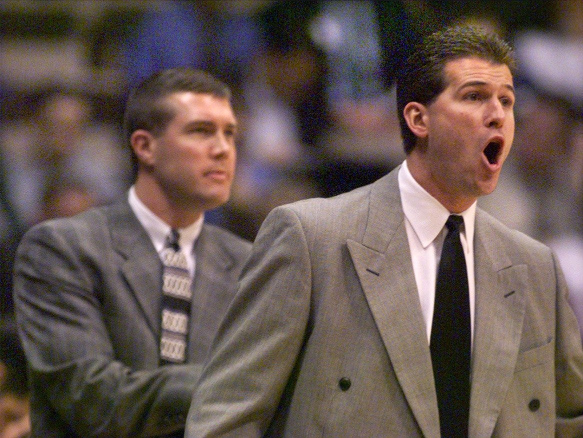 From 1999: Iowa men's basketball coach Steve Alford, right, and assistant coach Greg Lansing watch action during game vs. Texas Southern.