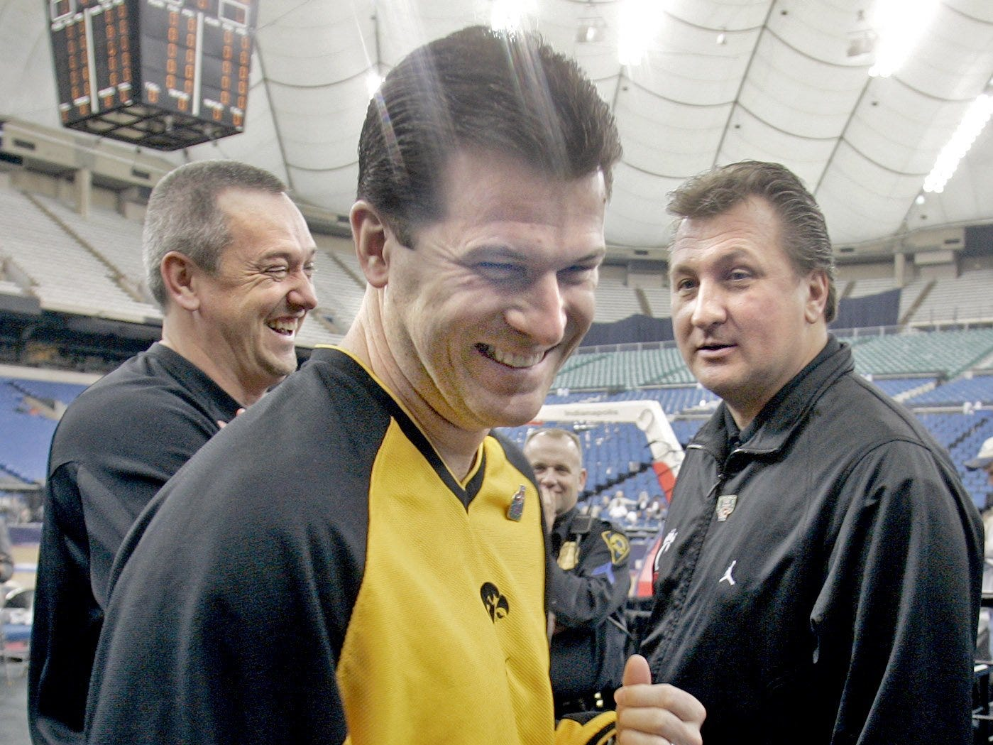 From 2005: Iowa coach Steve Alford, center, gets a kick out of Cincinnati coach Bob Huggins, right, who cracked a few jokes about Iowa associate head coach Craig Neal, left, and his buzz cut after practice at the RCA Dome before the NCAA Tournament in Indianapolis.